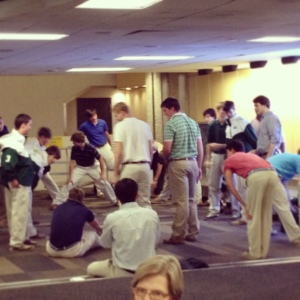 The team stretching after the flight while we waited on their luggage.